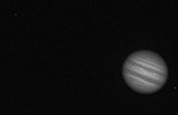 Jupiter with Io close to the right and then Europa on the left and Ganemede far left