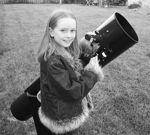 My daughter Zoe, back in 2003 with my old Dobsonian 8.75 inch reflector