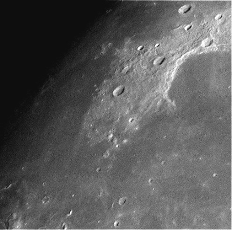 Sinus Iridium - The Bay of Rainbows is at the upper right. Bianchini is crater that almost enters it.